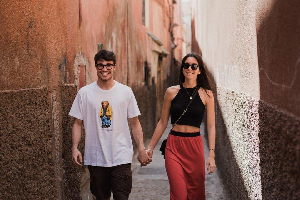 Couple walking in Marrakech Medina