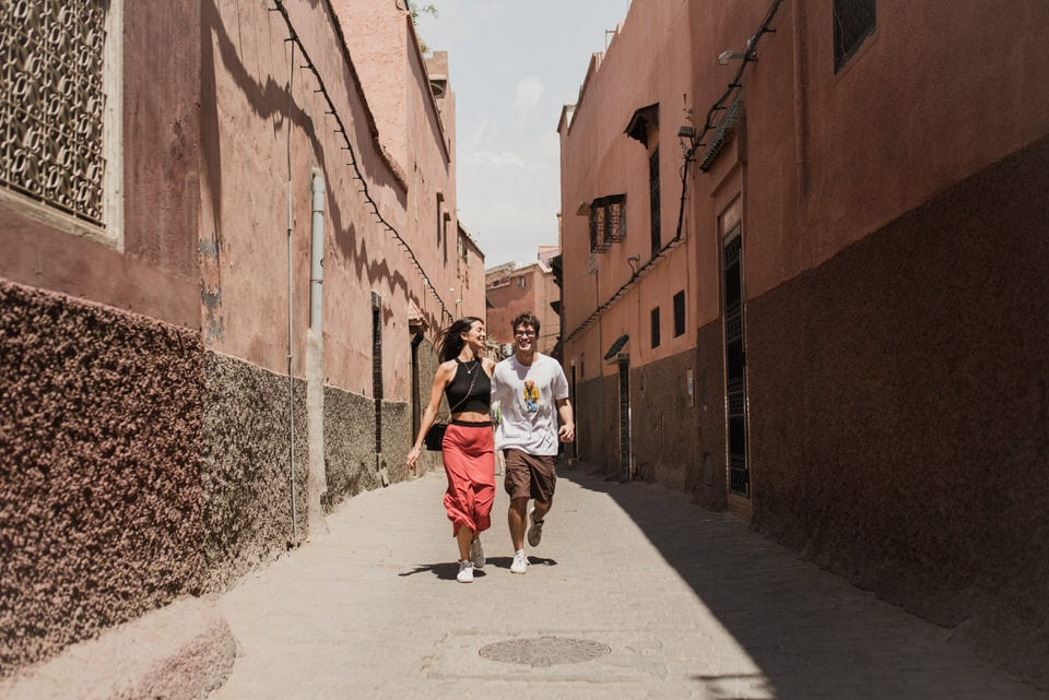 Couple walking in Marrakech Medina