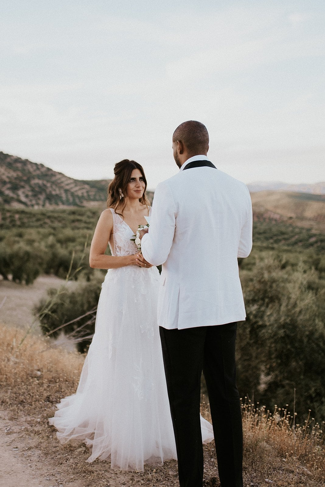 A bride and groom saying vows