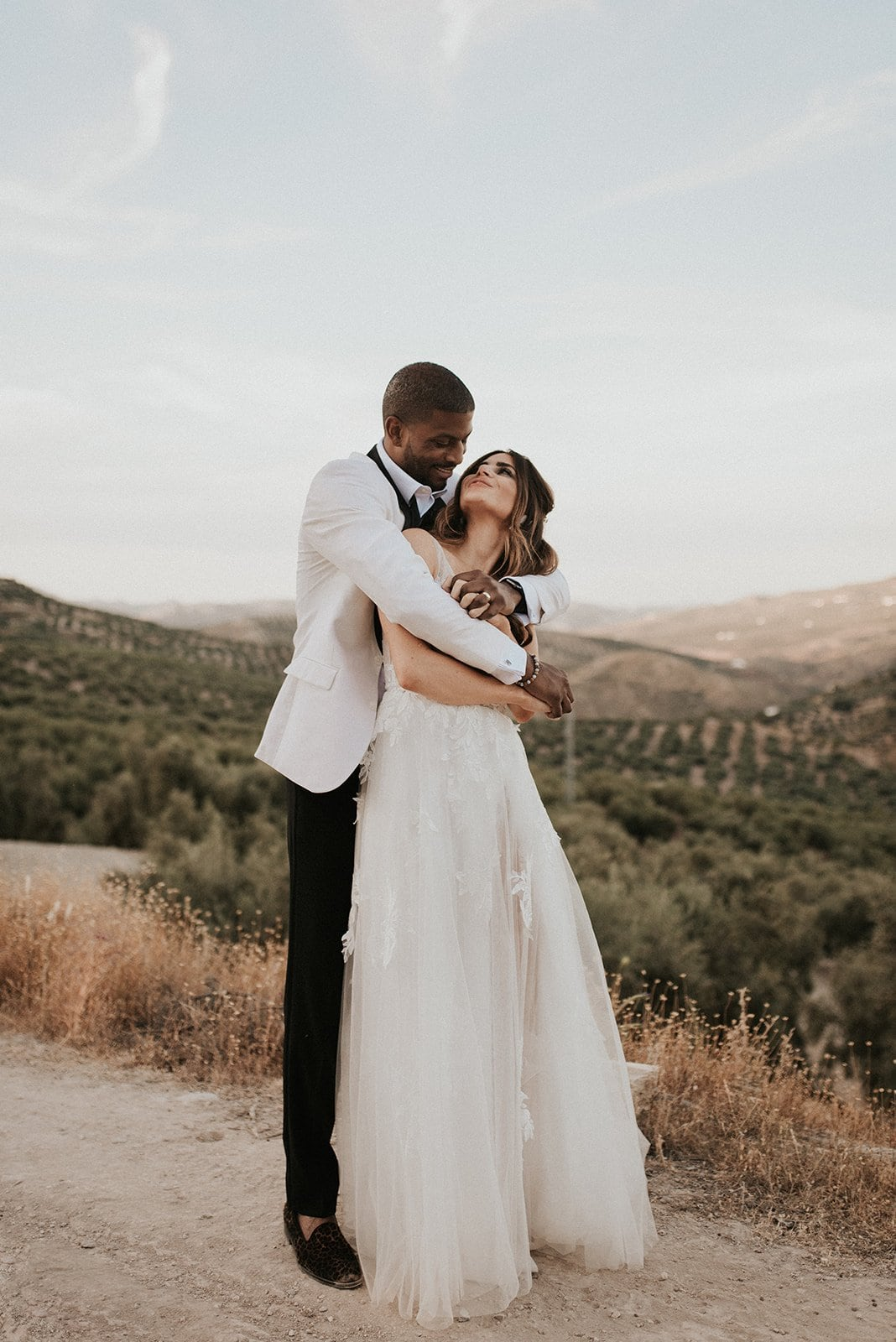 a couple holding each other on their wedding day