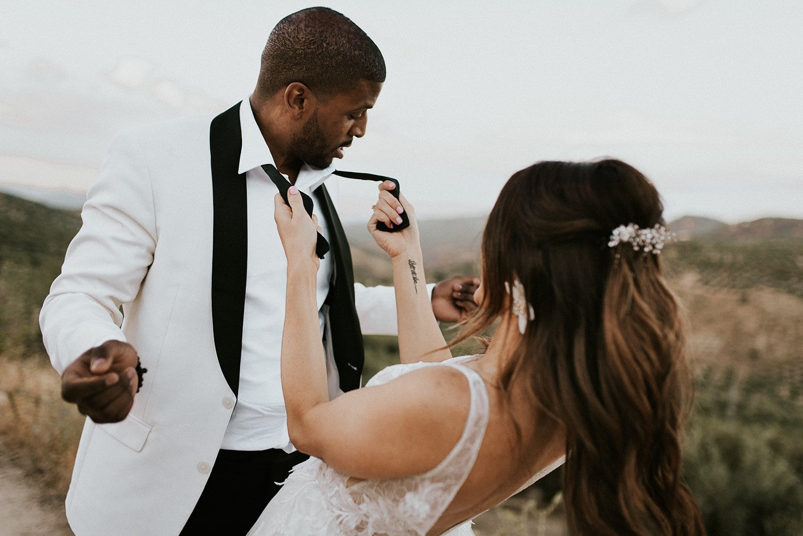 A bride and groom dancing during their spanish elopement