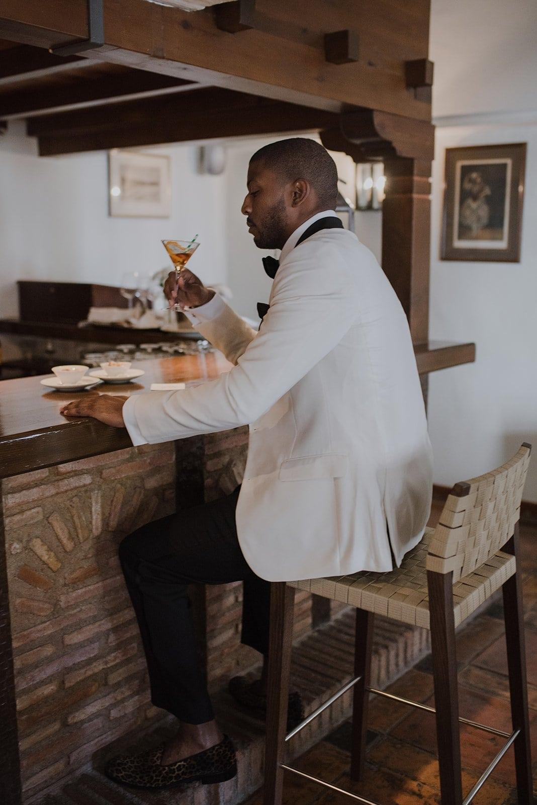 A groom drinking at La Bobadilla bar