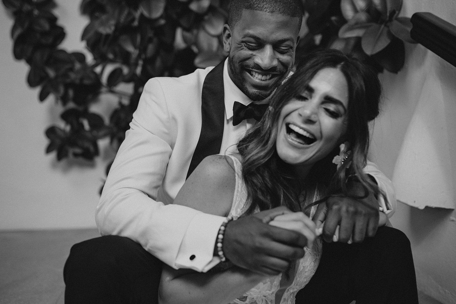 A couple laughing on a wedding day