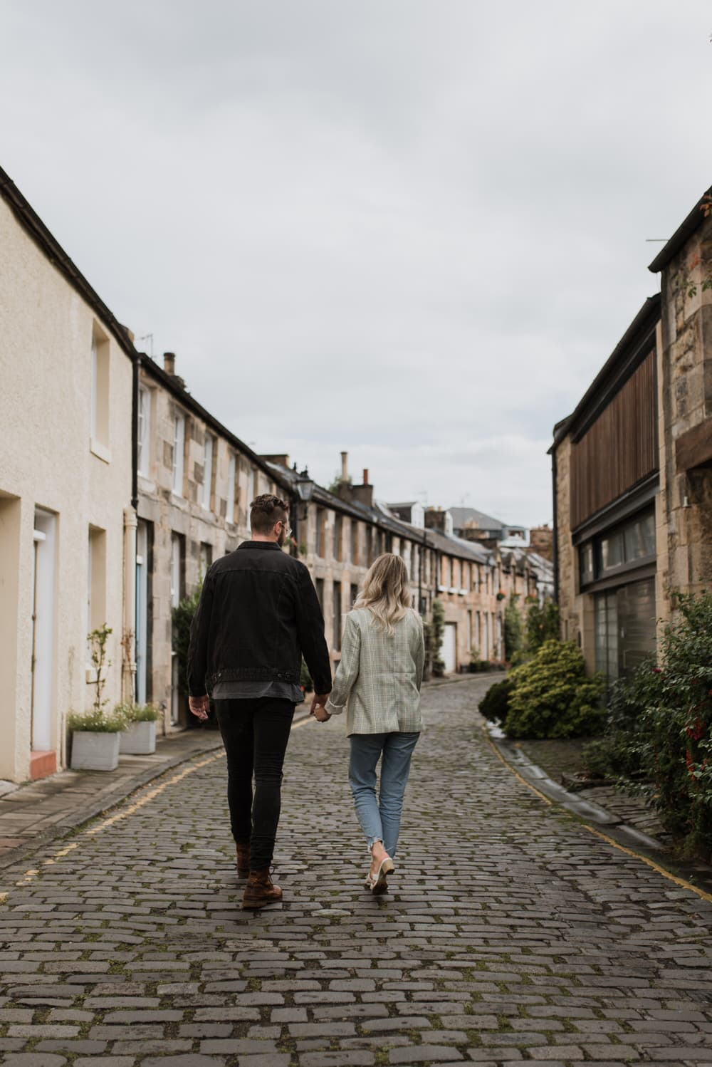couple walking on scotland city road