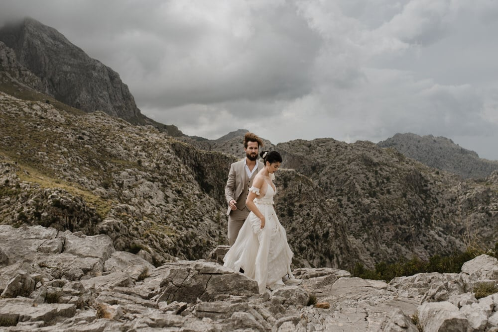 a couple walking in the mountains of spain