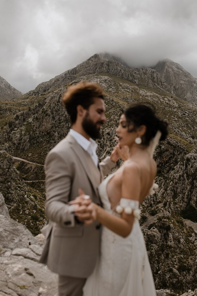 bride and groom in spanish mountains