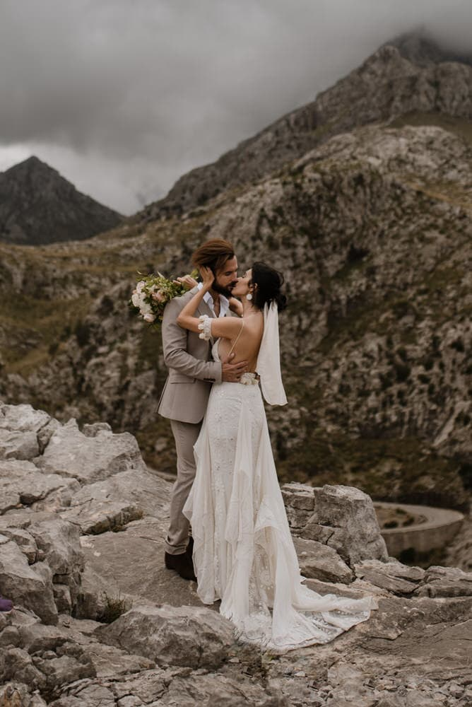 bride and groom first kiss on wedding in spain
