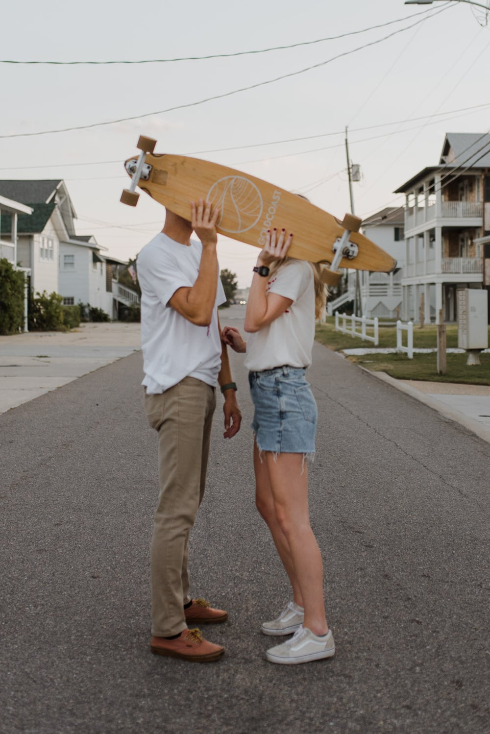 a couple with a skateboard