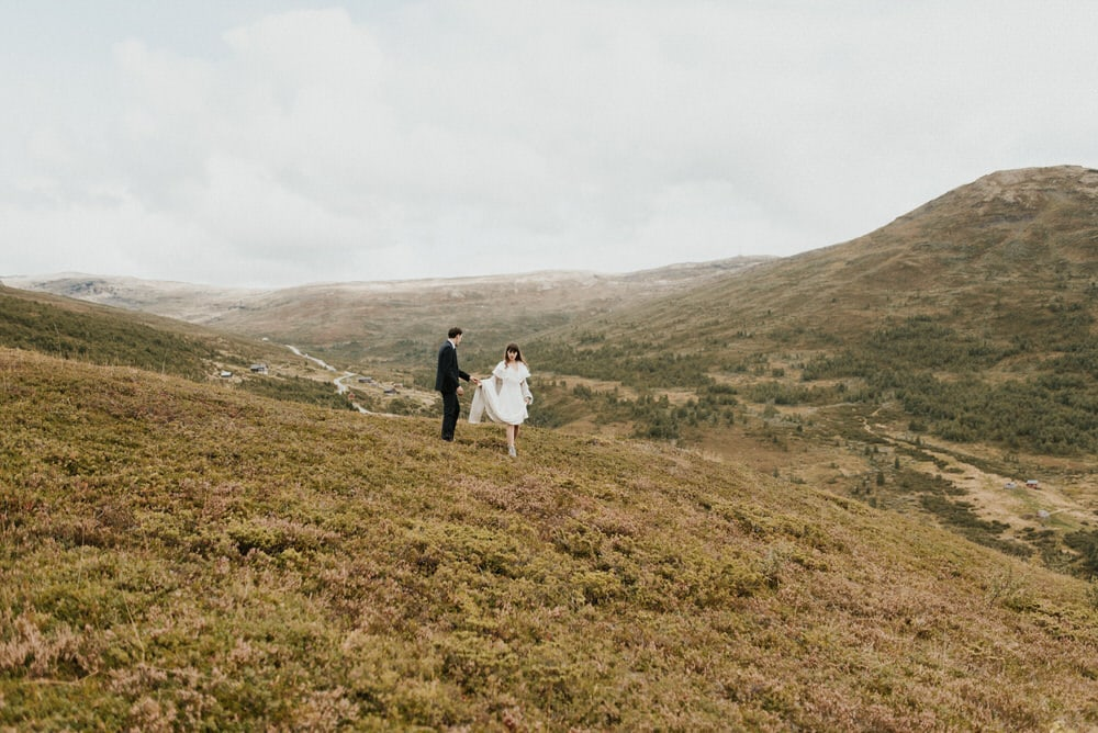A bride and groom eloping outdoors