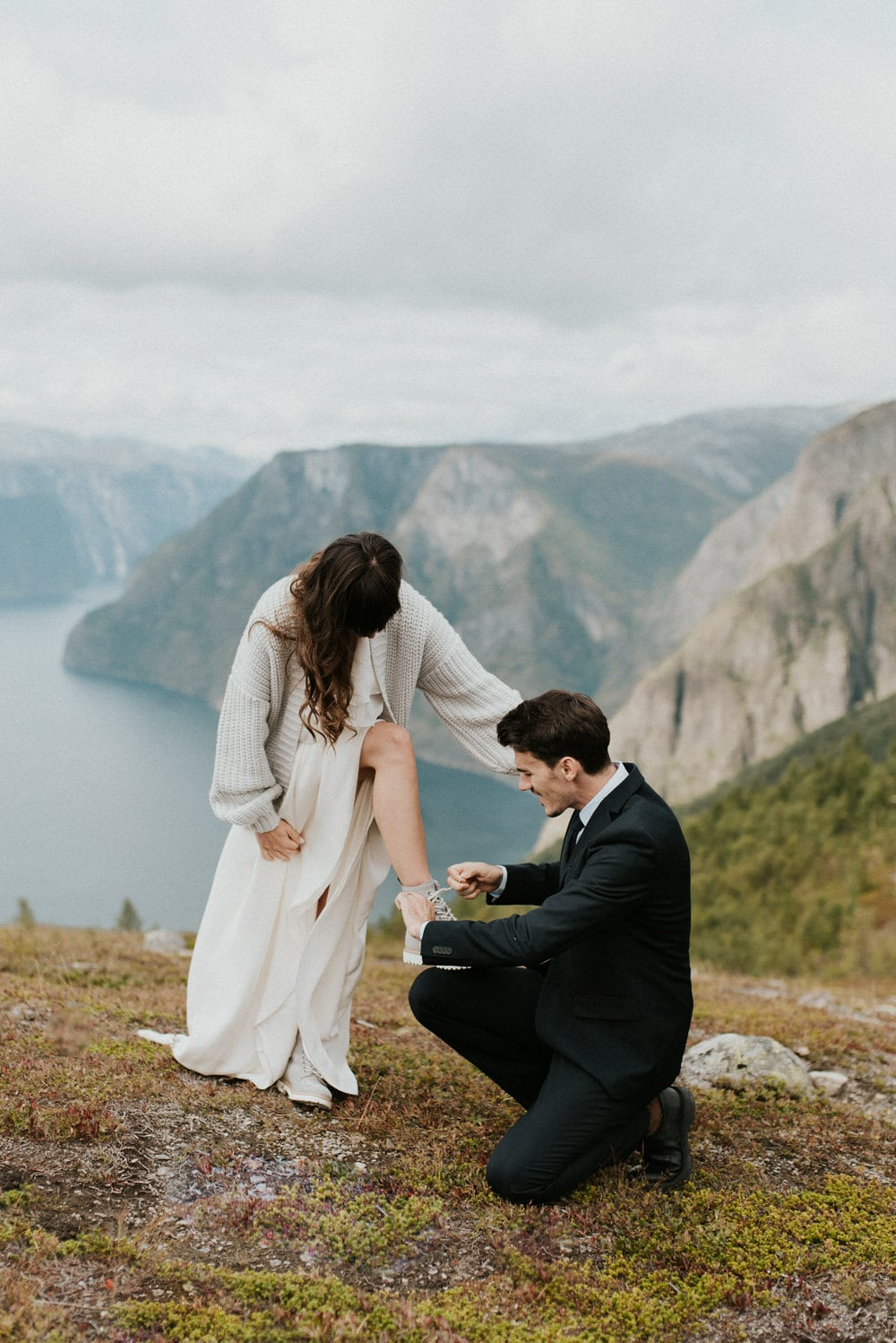 bride and groom hiking fashion wedding attire