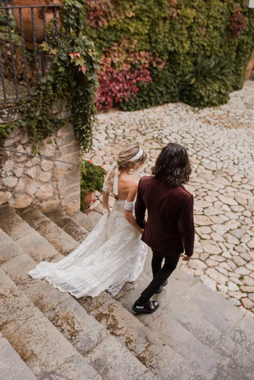 couple walking down the aisle at their mallorca wedding venue
