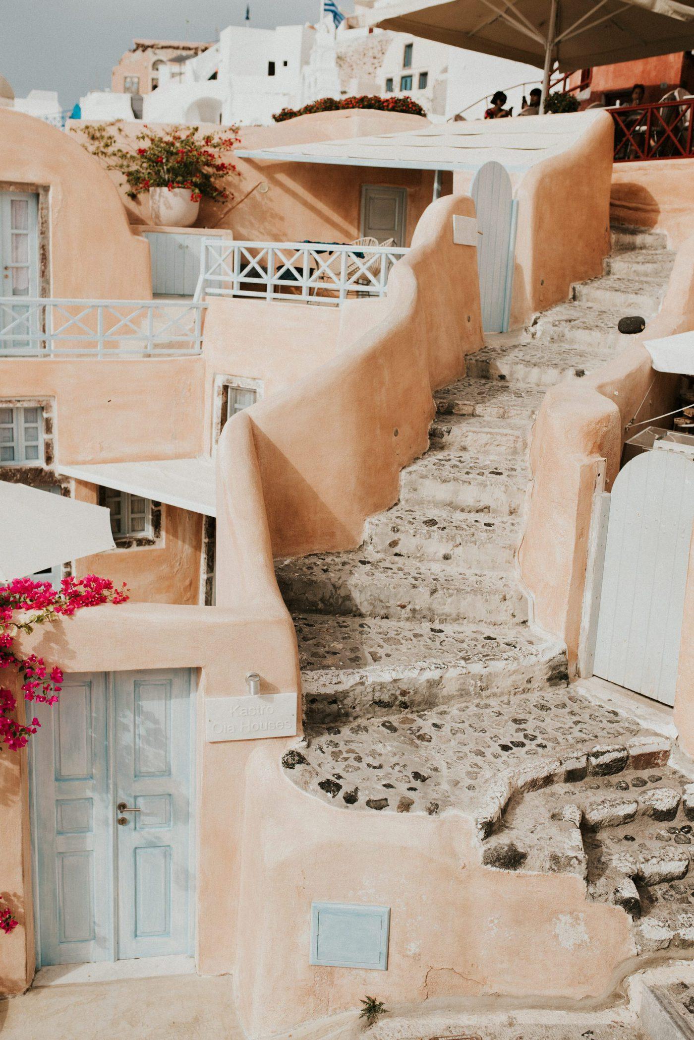 Santorini Elopement Planning pink villa in oia
